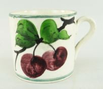 SMALL LLANELLY POTTERY MUG PAINTED WITH PLUMS on a branch, stencilled Llanelly to base, 7cms high