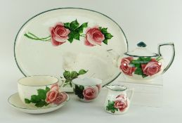 FIVE-PIECE LLANELLY POTTERY CABARET SET of tray, teapot, cup and saucer, cream-jug and sugar-