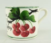 RARE LLANELLY POTTERY MUG PAINTED WITH CHERRIES ON A BRANCH the body inscribed 'A present for