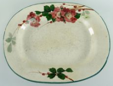 LLANELLY POTTERY MEAT PLATTER painted with briar roses with leaves, of rounded form, 41cms Condition