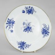 NANTGARW PORCELAIN CIRCULAR PLATE painted in blue with sprays of flowers and with gilt rim,