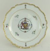 A RARE SWANSEA PEARLWARE PLATE BY HAYNES DILLWYN & CO of lobed form and having a feathered border,