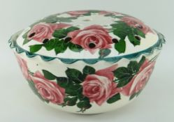 LLANELLY POTTERY ROSE BOWL painted with tea roses and foliage, circular footed with crimped rim, the