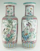 PAIR CHINESE FAMILLE ROSE PORCELAIN ROULEAU VASES, 19th Century, well painted with large opposing