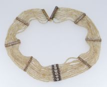 DIAMOND & SEED PEARL CHOKER NECKLACE having eight diamond encrusted bars, 38.5cms long Condition