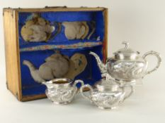 FINE BOXED CHINESE EXPORT SILVER THREE-PIECE TEASET BY WANG HING, c.1900 of bombe form, each