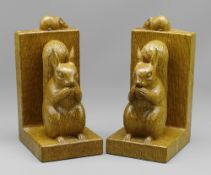 ROBERT 'MOUSEMAN' THOMPSON OF KILBURN: A PAIR OF CARVED OAK SQUIRREL BOOKENDS, each modelled with