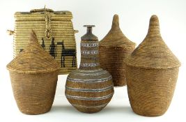 THREE AFRICAN BASKETS WITH CONICAL COVERS, possibly Tutsi, tallest 44cms, an Ethiopian wired