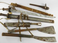 SIX ABOR WEAPONS, Assam, Northeast India, comprising three swords, two axes and an adze (6)