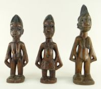 PAIR OF YORUBA MALE & FEMALE IBEJIS, Nigeria, 24cms and another, 30cms (3)