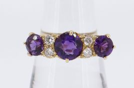 18CT GOLD SEVEN-STONE AMETHYST & DIAMOND RING, the three amethysts separated by four small