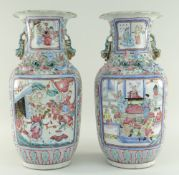 PAIR OF CHINESE CANTON FAMILLE ROSE PORCELAIN BALUSTER VASES, 19th Century, with everted petal
