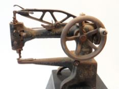 VICTORIAN SINGER SEWING MACHINE, MODEL 29K4, the leather working or cobblers model mounted on a cast