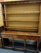 EARLY 19TH CENTURY WELSH OAK HIGH DRESSER with open three-shelf delft rack above base fitted three