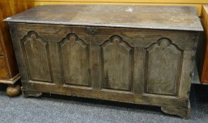 18TH CENTURY JOINED OAK COFFER with four arched panel front, 141cms wide Condition Report: top