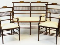 EDWARDIAN MARQUETRY INLAID MAHOGANY PART SALON SUITE comprising settee, two armchairs and five
