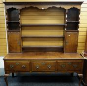 19TH CENTURY OAK SHROPSHIRE-TYPE HIGH DRESSER, dental cornice above ogee frieze and flute carved