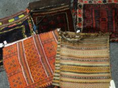 ASSORTED ORIENTAL TRIBAL SADDLE BAGS including two Soumak woven examples (5) Condition Report :