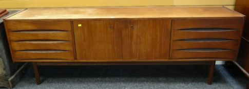 MID-CENTURY TEAK SIDEBOARD central cupboard between sets of drawers, 221 x 45.5 x 73cms