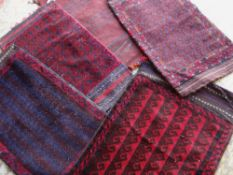 FIVE BALUCH TENT BAGS in various designs (5) Condition Report: all with insect damage to pile, to