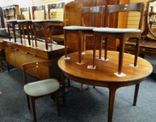 WITHDRAWN MID-CENTURY DANISH STYLE ROSEWOOD DINING SUITE comprising oval extending dining table