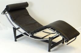 LE CORBUSIER-STYLE 'LC4' TYPE CHAISE LONGUE, bowed chrome frame, simulated leather upholstery with