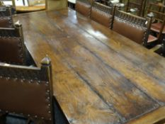 ANTIQUE ELM REFECTORY TABLE the four plank top with cleated ends on square baluster trestle end