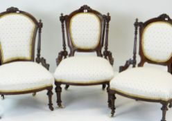 THREE LATE VICTORIAN WALNUT NURSING CHAIRS, similarly upholstered on turned fluted legs with ceramic