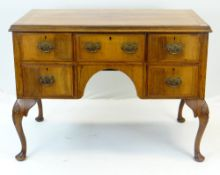 QUEEN ANNE-STYLE WALNUT DESK, fitted five drawers around an arched kneehole, carved cabriole legs,