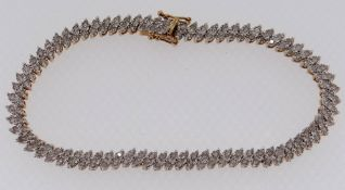 9CT GOLD LADIES BRACELET SET WITH A TWIN ROW OF DIAMOND CHIPS, 19.5cms long, 10.1gms