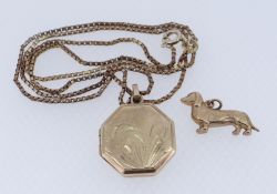9CT YELLOW GOLD OCTAGONAL LOCKET ON 9CT GOLD CHAIN, together with 9ct gold dachshund charm, 7.2gms