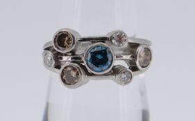 PLATINUM DIAMOND SEVEN-STONE RING (one blue, three brown, three white), 6.8gms