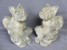RECONSTITUTED STONE WINGED SEATED GARGOYLES, a pair, 44cms H, 28cms W