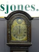 BRASS DIAL CARVED OAK LONGCASE the arched dial top marked 'Tempus Fugit', flanked by dolphin pierced