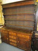 CIRCA 1820 WELSH OAK DRESSER the three shelf shape sided rack having wide back boards over a multi