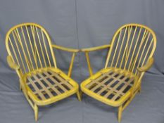 LIGHT ERCOL ARMCHAIRS, a pair having stick backs with hooped tops
