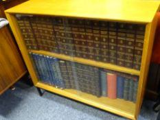 TEAK BOOKCASE containing 25 volume set of The Encyclopaedia Britannica and other books and bound