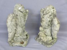 RECONSTITUTED STONE GARDEN ORNAMENTS, a pair, modelled as eagles standing on a duck's back