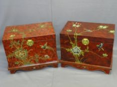 TWO JAPANESE SIMULATED RED LACQUER WORK CHESTS, a pair, lift-up lids with brass clasps and lined