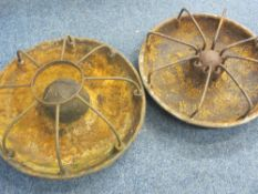 TWO CIRCULAR CAST IRON PIG FEEDERS, 75 and 70cm diameters