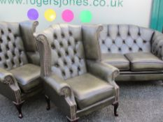 THREE PIECE LOUNGE SUITE - presumed leather and little used consisting of button backed three seater