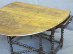 EARLY OAK BARLEY TWIST GATE-LEG DINING TABLE, twin-flap with single end drawer on barley twist