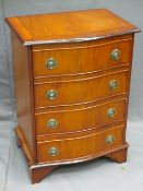 YEW WOOD SERPENTINE FRONT FOUR DRAWER CHEST, 70cms H, 51cms W, 37.5cms D
