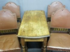 OAK DROP LEAF TABLE on turned supports with four rexine and studded dining chairs