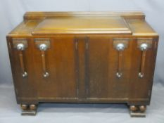 ART DECO OAK SIDEBOARD with railback and stepped top over an arrangement of four cupboard doors,