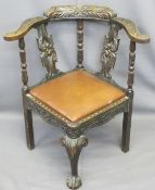 JACOBEAN STYLE CARVED OAK CORNER ARMCHAIR with drop-in rexine covered seat pad, 79cms H, 73cms W,