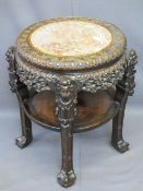 CHINESE CARVED HARDWOOD CIRCULAR STAND with pink marble inset top and under tier shelf, 68cms H,