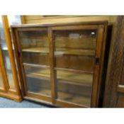 VINTAGE OAK BOOKCASE, glazed sliding doors with flush metal handles, plinth base, 122cms wide