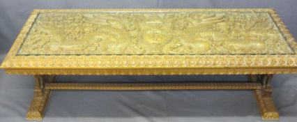 AN EASTERN HEAVILY CARVED LONG-JOHN COFFEE TABLE with a glazed top, 50cms H, 150cms W, 56cms D