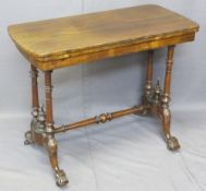 VICTORIAN WALNUT FOLDOVER CARD TABLE on turned columns and four splayed feet with cross stretcher,